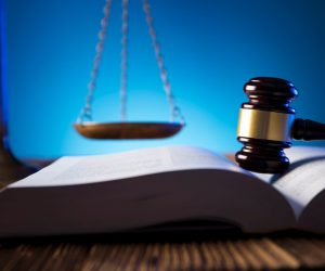 Photo of law book, gavel and scales of justice