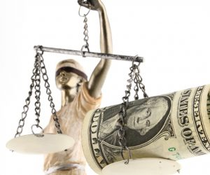 Money on scales of justice.